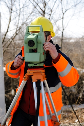 Land Surveyor Working on a Survey