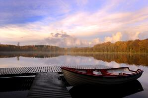 Autumn Sunrise On Lake with Boat